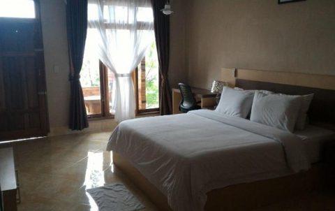 kamar di samosir villa resort